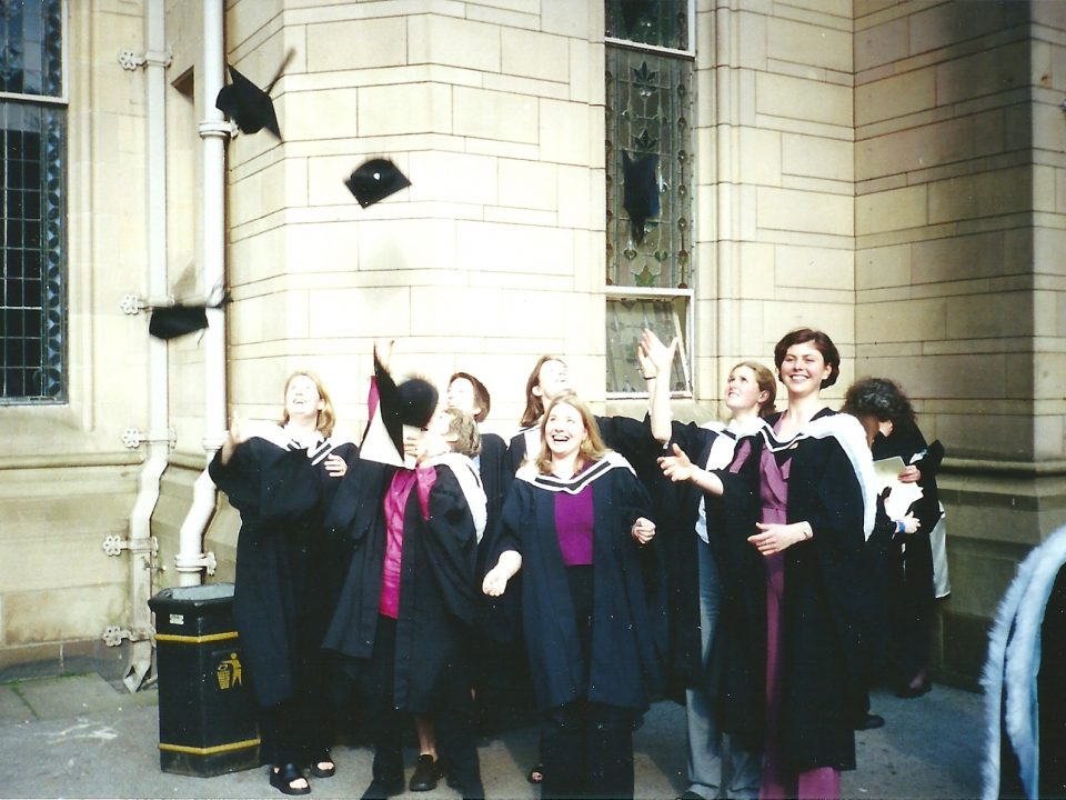 Graduates throwing their hats in the air