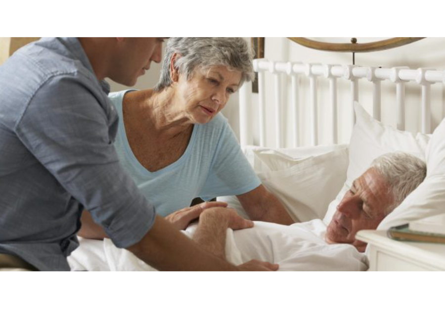 Dying person in a hospital bed